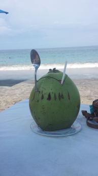 Young, green coconut on White Sandy Beach, Candidasa